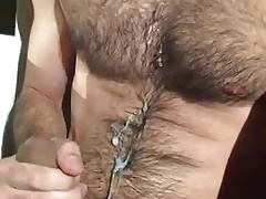 Jerking on hairy chest