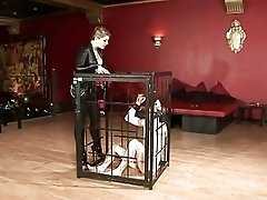 Sexy latex Mistress dominating her caged slave