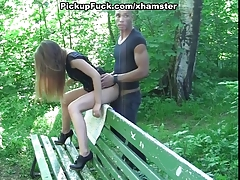 Sexy blonde fucked on a park bench