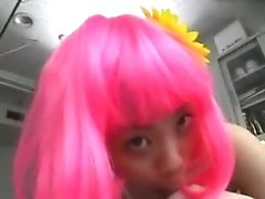 Asian girl with pink wig gives head