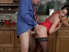 German MILF in red dress and stockings fucked in the kitchen